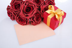 Blank card with red flowers and gift Royalty Free Stock Photography