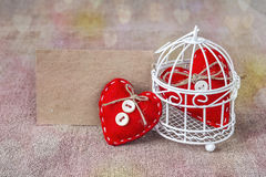 Blank card with red hearts in a cage Royalty Free Stock Photography