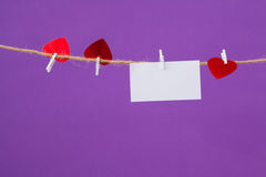 Blank card and red hearts hanging on the rope Stock Image