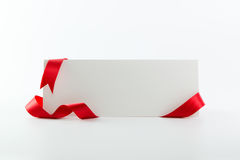 Blank card with red ribbon Royalty Free Stock Photography