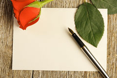 Blank card and a red rose Royalty Free Stock Photos