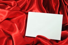 Blank card on red silk Stock Photos