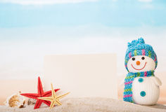 Blank card, sea shells, stars and snowman in  sand. Stock Images