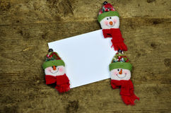 Blank card with snowman faces Royalty Free Stock Image