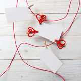 Blank card for text with clothespins hearts.Symbol of love. Royalty Free Stock Photos