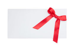 Blank card tied with a bow of red ribbon Stock Images