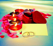 Blank card and two rings and candles Stock Photo