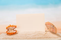 Blank card, an umbrella and a shell Royalty Free Stock Image