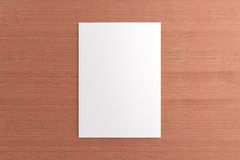 Blank card on wooden background. Blank opened card or flyer on wooden background, to replace message or image on cover Royalty Free Stock Photo