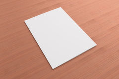 Blank card on wooden background. Blank opened card or flyer on wooden background, to replace message or image on cover Royalty Free Stock Photography