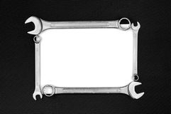 Blank card with wrenches. On the black dotted metal plate Royalty Free Stock Images