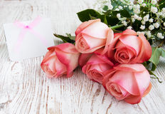 Blank card for your message and pink roses Stock Image