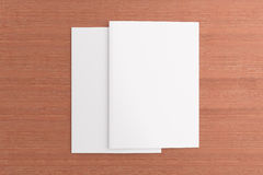 Blank cards on wooden background. Blank cards or flyer on wooden background, to replace message or image on cover Stock Images