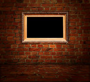 Blank Carved Gilded Frame on Red Brick Background Royalty Free Stock Photos
