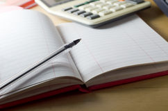 Blank Cash Book and Calculator Royalty Free Stock Images