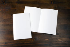 Blank catalog, brochure, book mock up. Empty magazines on wooden background Stock Photography