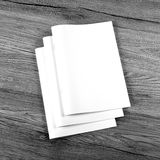 Blank catalog, brochure, magazines, book on wooden background Royalty Free Stock Images