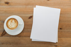 Blank catalog, magazines,book mock up on  wood background. With cup of coffee Stock Photography