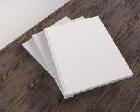 Blank catalog, magazines,book mock up on wood background 3d illustration. Textbook,  texture,  tissue,  up,  velvet,  wave,  white,  wood Royalty Free Stock Photos