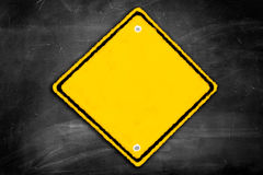 Blank caution sign on a black chalkboard. With room for print stock photography