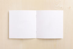 Blank CD booklet on wood Royalty Free Stock Images