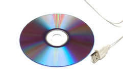 Blank CD-DVD disk and white USB cable. Isolated on white background. Close-Up shot Stock Photo