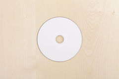 Blank CD on wood Royalty Free Stock Photo