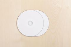 Free Blank CDs On Wood Royalty Free Stock Photography - 15902317