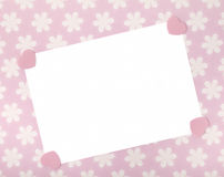 Blank celebrations card on pastel pink floral background. Stock Image