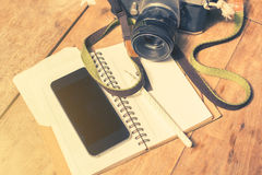 Blank cell phone, diary and old photo camera, vintage photo effe Stock Photo