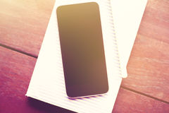 Blank cell phone, diary and pen Stock Photos