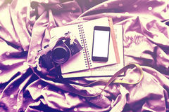 Blank cell phone, old style camera, blank diary and a book Royalty Free Stock Image