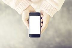 Blank cell phone in the women's hands Stock Images