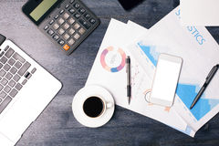 Blank cellphone and business report Stock Images