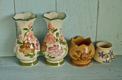 Blank ceramic vases on the shelf. Blank ceramic vases on the blue wood shelf royalty free stock image