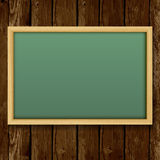 Blank chalk green board in a wood frame for write and teach on w Stock Photos