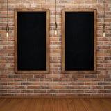 Blank chalkboard on brick wall with glowing light bulbs. 3D rendering Stock Image