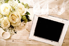 Blank Chalkboard with Bridal Bouquet and Lace Veil Royalty Free Stock Image