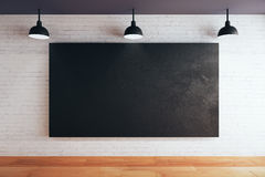 Blank chalkboard. Blank chalboard on brick wall in room with wooden floor and ceiling with lamps. Mock up, 3D Rendering Royalty Free Stock Image