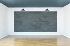 Blank chalkboard. Blank chalkbord in room with wooden floor and concrete walls. Mock up, 3D Rendering Royalty Free Stock Images