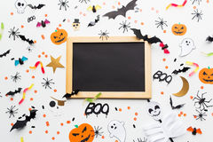Blank chalkboard and halloween party decorations Stock Images