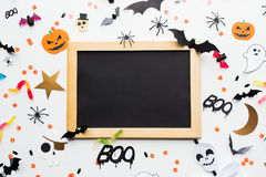 Blank chalkboard and halloween party decorations Royalty Free Stock Photos