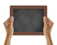 Blank Chalkboard. Hand holding blank chalkboard isolated on white Stock Image