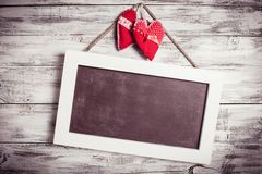 Blank chalkboard and hearts Royalty Free Stock Images