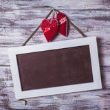 Blank chalkboard and hearts Royalty Free Stock Photos