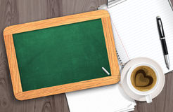 Blank chalkboard with paper and coffee Royalty Free Stock Image