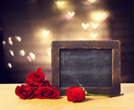 Blank chalkboard with red roses Royalty Free Stock Images