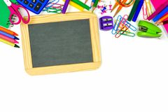 Blank chalkboard with school supplies border Royalty Free Stock Image