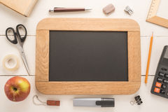 Blank chalkboard with school supplies Royalty Free Stock Photos