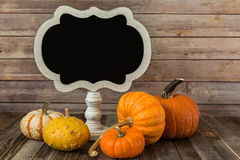 Blank chalkboard sign with decorative gourds Stock Photography